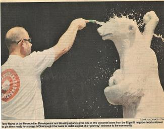 Tennessean clipping from 2003, showing an MDHA employee cleaning one of the bears
